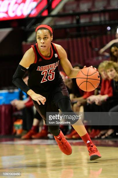 Asia Durr guard Louisville Cardinals dribbles the basketball down court against the Florida State University Seminoles in an Atlantic Coast...