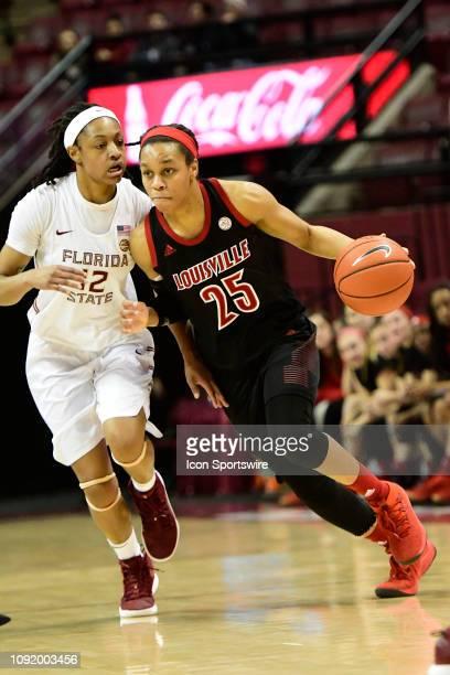 Asia Durr guard Louisville Cardinals dribbles the basketball down court against Nicki Ekhomu guard Florida State University Seminoles in an Atlantic...