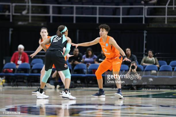 Asia Durr of New York Liberty shoots the ball against Layshia Clarendon of Connecticut Sun on May 19 2019 at the Times Union Center in Albany New...