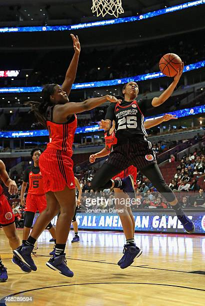 Asia Durr of the East team puts up a shot against Kalani Brown of the West team during the 2015 McDonalds's All American Game at the United Center on...