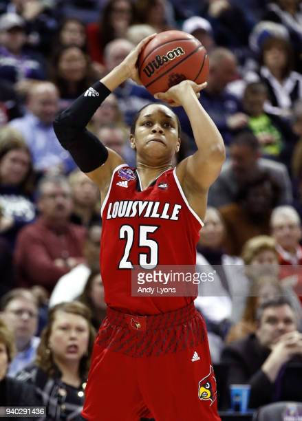 Asia Durr of the Louisville Cardinals attempts a jump shot against the Mississippi State Lady Bulldogs during the second half in the semifinals of...