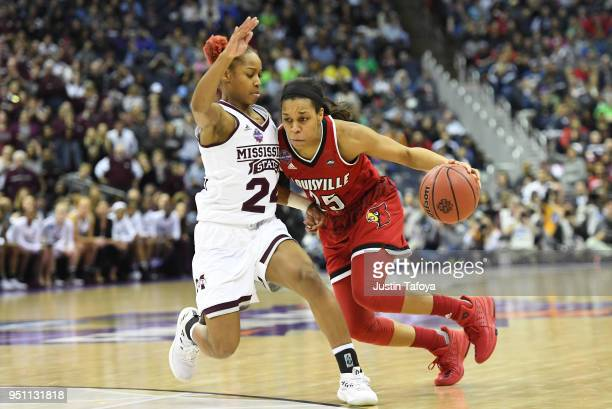 Asia Durr of the Louisville Cardinals is guarded by Jordan Danberry of the Mississippi State Lady Bulldogs during the semifinal game of the 2018 NCAA...