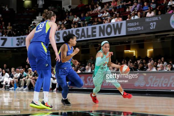 Asia Durr of the New York Liberty handles the ball against the Dallas Wings on June 28 2019 at the Westchester County Center in White Plains New York...
