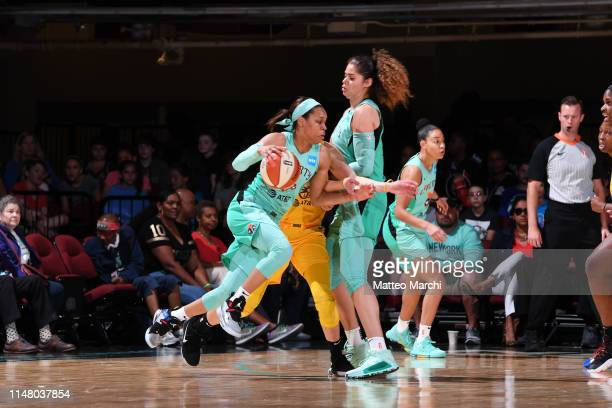 Asia Durr of the New York Liberty handles the ball against the Los Angeles Sparks on June 4 2019 at the Westchester County Center in White Plains New...
