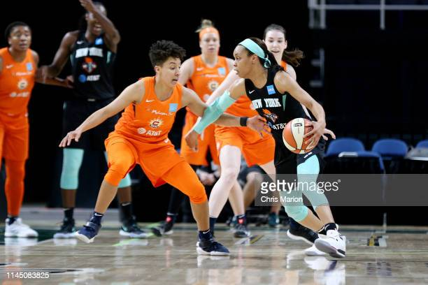 Asia Durr of the New York Liberty handles the ball against the Connecticut Sun on May 19 2019 at the Times Union Center in Albany New York NOTE TO...