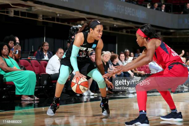 Asia Durr of the New York Liberty handles the ball during the game against the Washington Mystics on June 7 2019 at the Westchester County Center in...