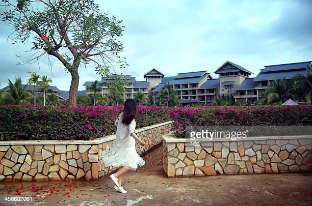 Asia girl running in the garden