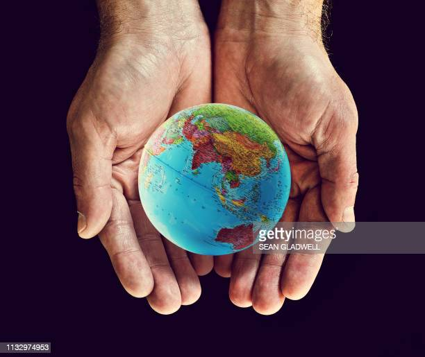 asia globe in hands - social issues stock pictures, royalty-free photos & images