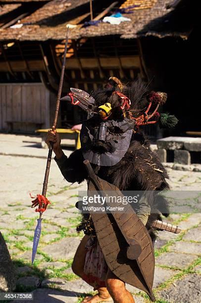 Asia Indonesia Sumatra Nias Island Bawomataluo Village War Dancer In Traditional Dress And Mask
