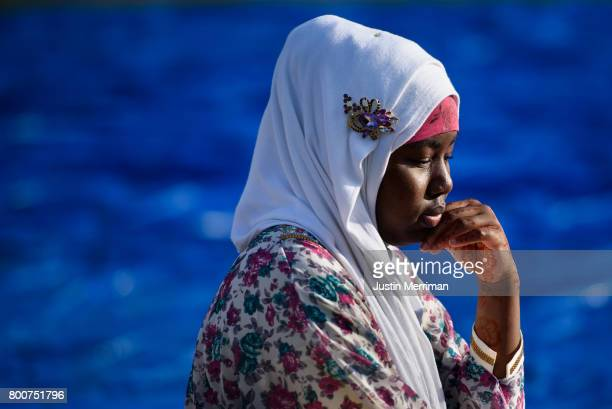 Asia Mada of Sharpsburg Pa waits for prayer to begin during an Eid alFitr celebration marking the end of Ramadan on June 25 2017 in Pittsburgh...