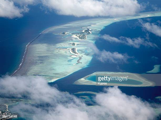 Asia, Maldives, Aerial View Of Small Tropical Islands (Green) Surrounded By Coral Reef (Light Blue) And Indian Ocean 'n