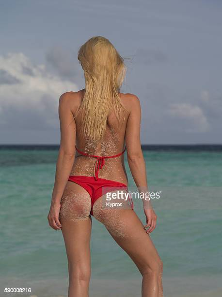 asia, maldives, close up of young attractive female model posing in bikini on beach - big bums stock photos and pictures