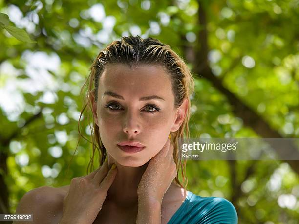 """asia, maldives, headshot facial portrait of an attractive young caucasian woman on a tropical beach alone """"n - n n girl model stock photos and pictures"""