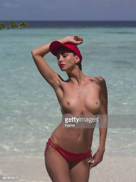 Asia, Maldives, View Of Young Topless Woman On Beach