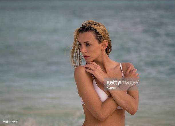 "asia, maldives, young caucasian woman thinking, wearing bikini on beach ""n - little girls giving head stock photos and pictures"