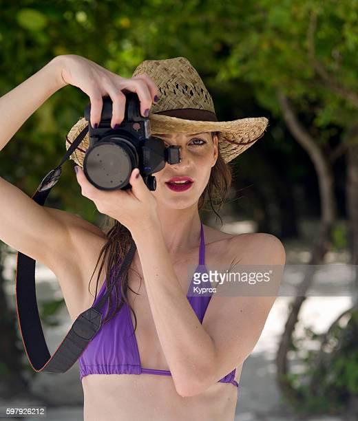 Asia, Maldives, Young Caucasian Woman Wearing Bikini On Tropical Beach