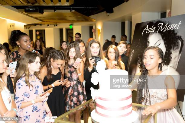 Asia Monet celebrates her birthday with a cake at her Asia Monet's 12th Birthday Party at OUE Skyspace LA on August 10 2017 in Los Angeles California