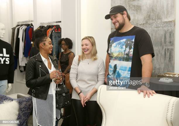Asia Saffold, Meaghan Conway and NFL offensive tackle Rob Havenstein attend the LA Rams Wives and Girlfriends Holiday Gifting Event at Westfield...