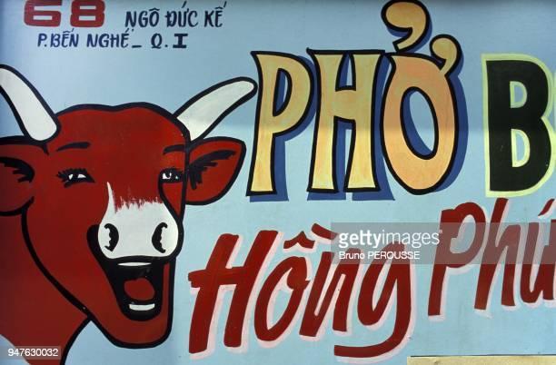 Asia Vietnam Ho Chi Minh city restaurant sign with La Vache Qui Rit logo