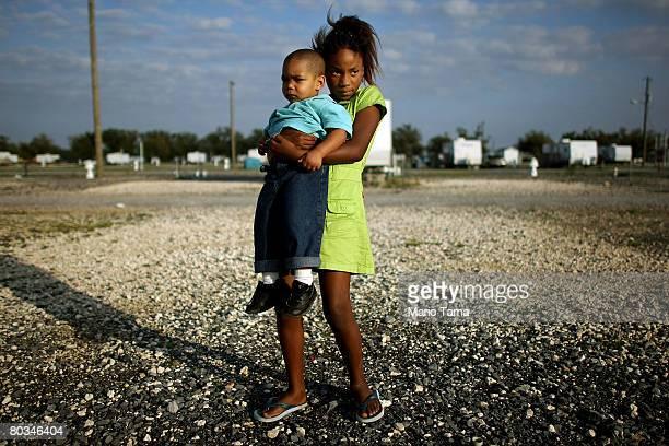 Asia Williams holds Brandon Encalade in the FEMA Diamond travel trailer park March 21, 2008 in Port Sulphur, Louisiana. The FEMA federal trailer...