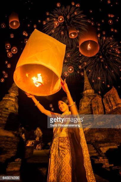 asia woman  floating lamp - loi krathong stock photos and pictures