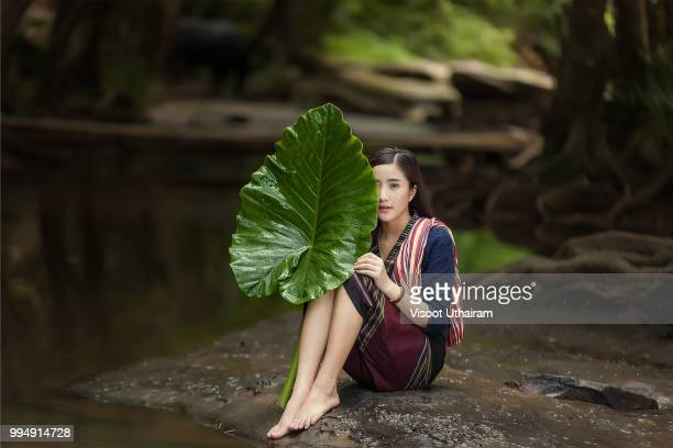 Asia women with nature in the rainy season