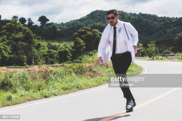 Asia young docter are running at rural road .