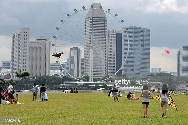 Asiaeconomyfinancebankrates FOCUS by Martin Abbugao This photo taken on June 21 2010 shows the Singapore Flyer standing against the business district...