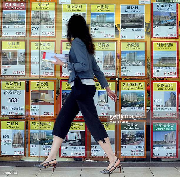 AsiaeconomypropertyFOCUS by Martin Abbugao A woman walks past a property agent window in Hong Kong on March 3 2010 Asian countries fearing a USstyle...