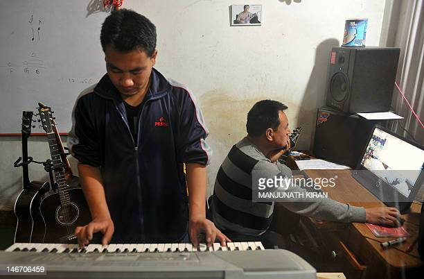AsiamusicIndiaentertainmentunrest by Abhaya Srivastava This photographs taken on February 21 shows Indian musicians engaged in a recording session at...