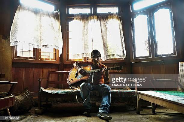 AsiamusicIndiaentertainmentunrest by Abhaya Srivastava This photograph taken on February 21 shows 49yearold Jianngam Kamei a popular local music...