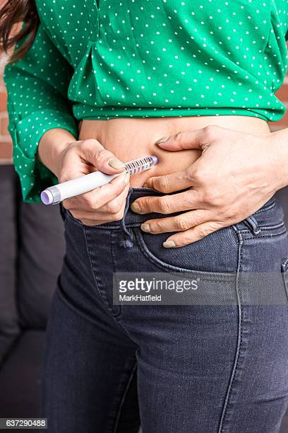 Asian Adult Using Insulin Pen