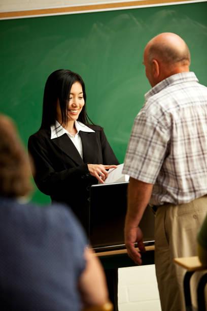Asian American Teacher Runs Adult Education Class