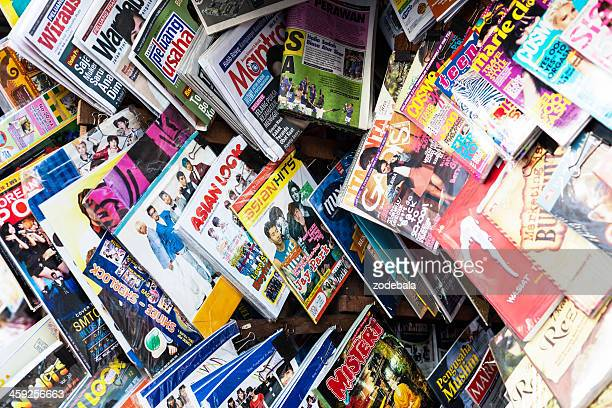 asian and western magazines on a newsstand - pornographic magazine stock photos and pictures