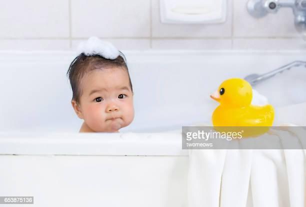 Asian baby boy in bathtub.