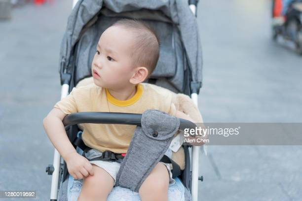 asian baby boy in pram - three wheeled pushchair stock pictures, royalty-free photos & images