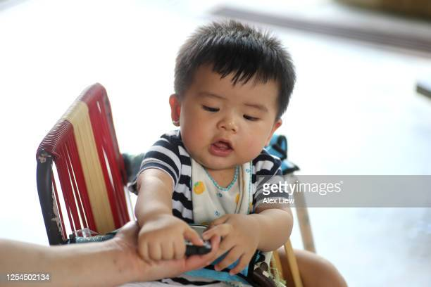 asian baby boy - one baby boy only stock pictures, royalty-free photos & images