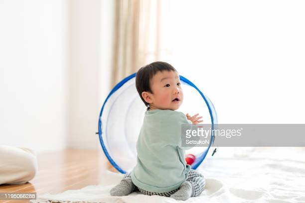 asian baby boy playing with colorful balls - one baby boy only stock pictures, royalty-free photos & images