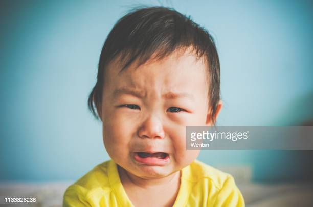 a asian baby crying - crying stock pictures, royalty-free photos & images