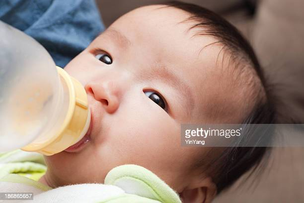 Asian Baby Feeding from a Bottle
