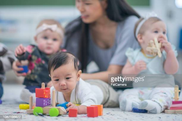 asian baby playing with toys - fatcamera stock pictures, royalty-free photos & images