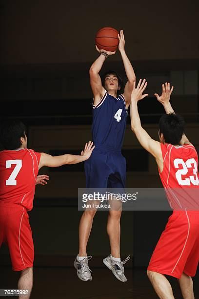 Asian Basketball Player Making a Jump Shot
