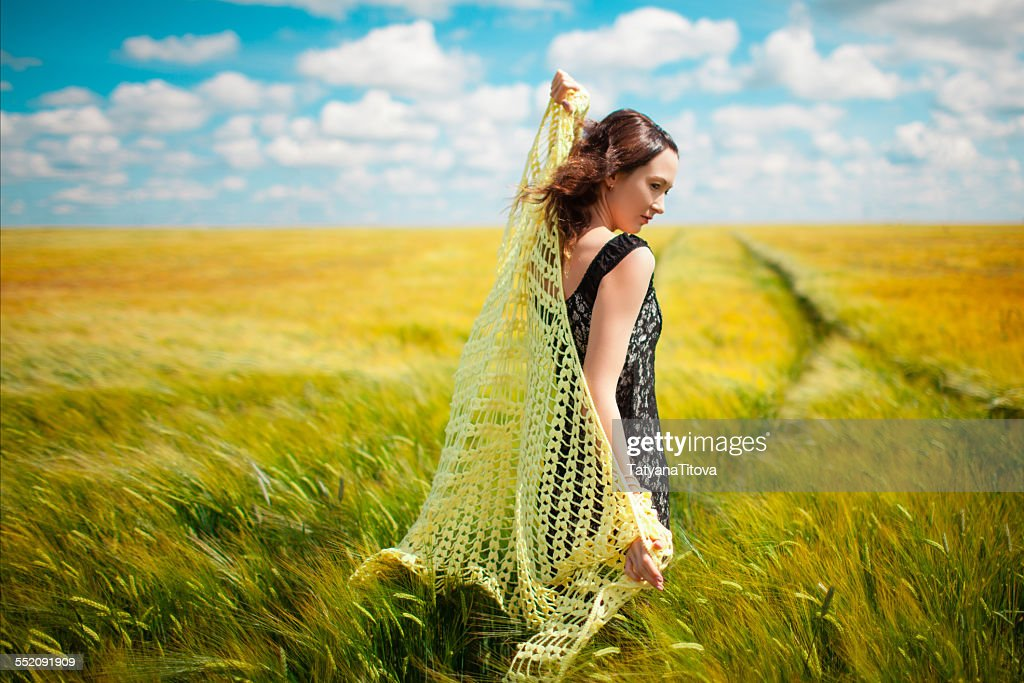 Asian beautiful girl with knitted shawl in wheat f : ストックフォト