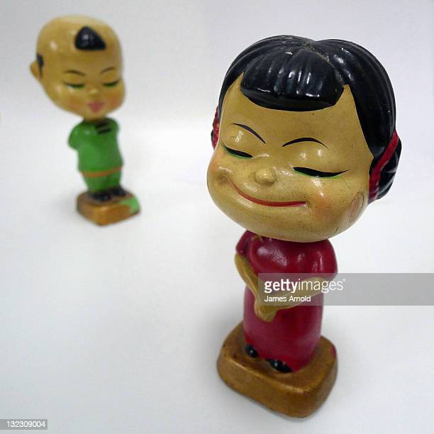 asian bobbing head dolls male and female - bobble head doll stock photos and pictures