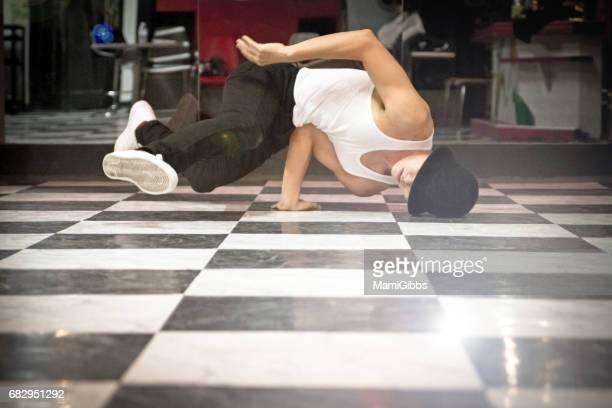 Asian boy breakdancing