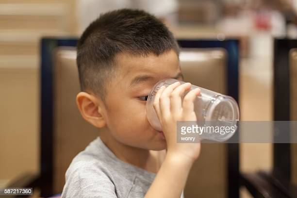 Asian boy drink water