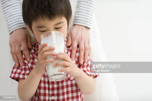 asian boy drinking milk - asian drink stock photos and pictures