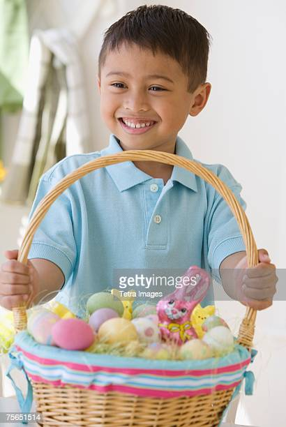 Asian boy holding Easter basket