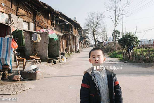asian boy in old china town street