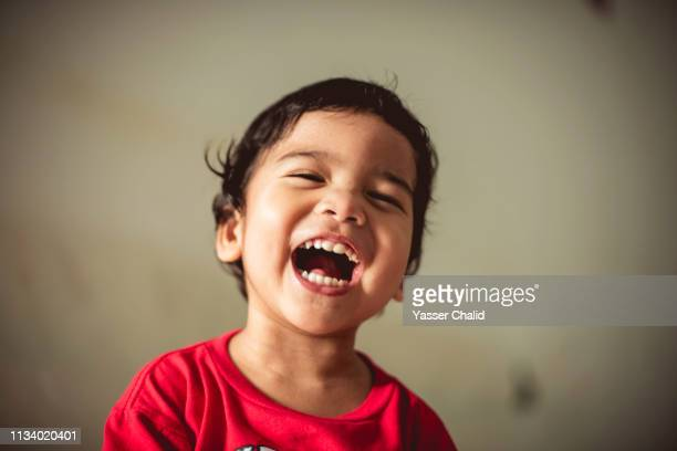 asian boy laughing - lol stock photos and pictures